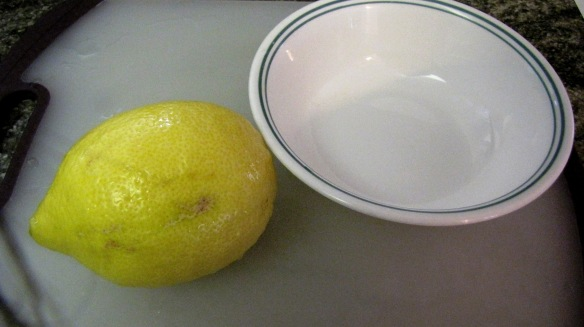 - One large fresh lemon or two small fresh lemons - Olive oil - Grounded sugar - Salt - Pepper