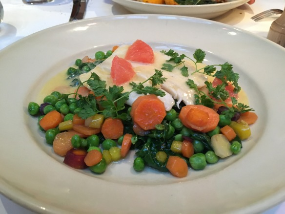 Halibut with spinach, carrots, sweet peas, and ginger-citrus beurre blanc. This exhilarating dish embodies the heart and soul of California Cuisine: freshness and fusion.