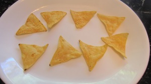 Place tortilla chips on a plate.