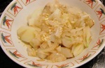Cut half an onion into small pieces. Mix with cooked sunchoke and potato pieces and minced garlic.