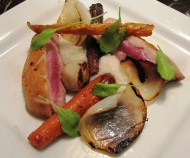 Crispy Duck Breast with Sunchoke Purée, Charred Onion, and Rainbow Carrots