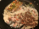 (Optional) Add the cooked ground meat to the pan, and mix.