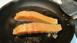 Season the salmon with salt and pepper and heat on pan until both sides are golden.