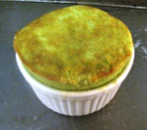 After about 15 minutes in the oven, the matcha cake puffed in the ramekin. Take out of oven.